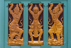 Thai marquetry decorated on temple wall Royalty Free Stock Photo