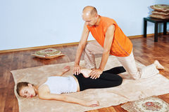 Thai massage. Masseur makes Thai massage girl stock images