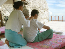 Thai Massage. Surrounding by cliffs, vegetation and ocean to aid relaxation royalty free stock photo