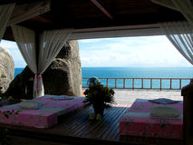 Thai Massage Area. Thai massage place surrounding by cliffs and ocean to aid relaxation stock image