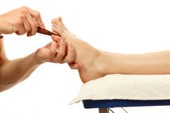 Thai massage foot female close-up isolated on white Royalty Free Stock Photo