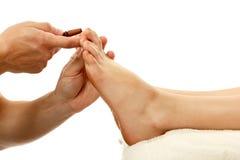 Thai massage foot female close-up isolated on white Stock Photos