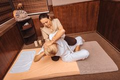 Top view of a process of Thai massage. Thai massage session. Top view of a process of Thai massage in a professional spa salon stock photo