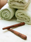 Thai massage sticks and towel Royalty Free Stock Photo