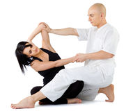 Thai massage stretching Stock Photo