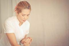 Thai massage therapist massaging feet Royalty Free Stock Images