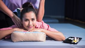 Thai massage to Asian female in spa stock photography