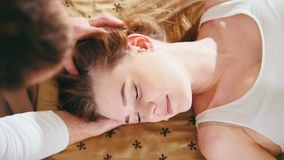 Thai massage treatment for head and face - white young blonde girl model stock footage
