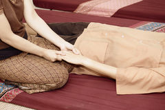 Women pay attention to relaxation and health. Thai massage. Women pay attention to relaxation and health Stock Photo