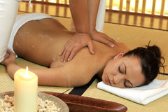 Thai-Massage. Young woman relaxing with a thai massage royalty free stock image