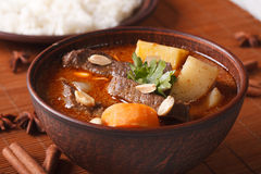 Thai massaman curry with beef and peanuts macro. Horizontal Stock Photography