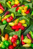 Thai Massapa`es ,Look Choup, Colorful deletable imitation fruits in banana leave container stock photo