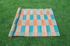 Thai mat on the green grass Royalty Free Stock Photography