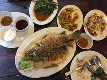 Thai meal in a restaurant. Which consist of fish, stinky beans, water spinach, mango salad which are all cooked in traditional Thai style royalty free stock image