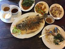 Thai meal in a restaurant. Which consist of fish, stinky beans, water spinach, mango salad which are all cooked in traditional Thai style stock images