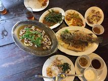 Thai meal in a restaurant. Which consist of fish, stinky beans, water spinach, mango salad which are all cooked in traditional Thai style royalty free stock images