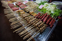 Thai meat ball and sausage with bamboo stick Stock Images