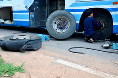 Thai mechanic people repairing and fix change wheel tire of bus. Broken and explosion on the road at countryside on May 3, 2015 in Bangkok, Thailand Stock Images