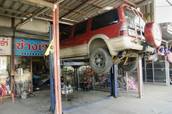 Thai mechanic professional motor repair and maintenance change oil and Check availability of car Royalty Free Stock Photography