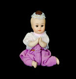 Thai medieval child doll with black isolation. Thai medieval child doll in black isolation background Stock Image