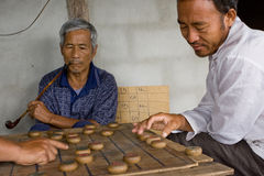 Thai men are playing Chinese chess - XiangQi Royalty Free Stock Photography