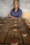 Thai men are playing Chinese chess - XiangQi Stock Image