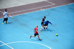 Thai men playing football or soccer Stock Image