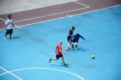 Thai men playing football or soccer Stock Image