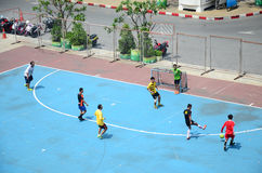 Thai men playing football or soccer Royalty Free Stock Image