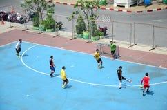 Thai men playing football or soccer Royalty Free Stock Image