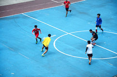 Thai men playing football or soccer. On field at front of sport stadium on April 5, 2015 in Bangkok Thailand Royalty Free Stock Images