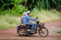 Thai men riding a cross motorbike Royalty Free Stock Photos