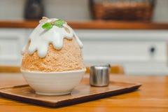 Thai milk tea ice shave. Dessert with caramel cream stock image
