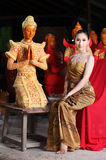 Thai model and wax statue Royalty Free Stock Photography