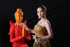 Thai model and wax statue Stock Image