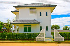 Thai modern style house from front. White Thai modern style wooden house from front with door Royalty Free Stock Photos