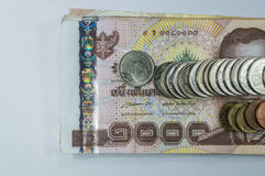 Thai Money, 1000 baht banknotes and coin on white background. Royalty Free Stock Photos