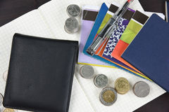 Thai money and bank saving account book on wooden table Royalty Free Stock Photography