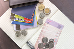 Thai money and bank saving account book on wooden table, Stock Image
