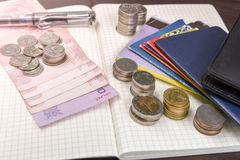 Thai money and bank saving account book on wooden table, Stock Photo