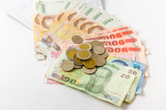 Thai money with bank statement Royalty Free Stock Photos