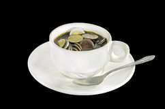 Thai money coins in a coffee cup Royalty Free Stock Image