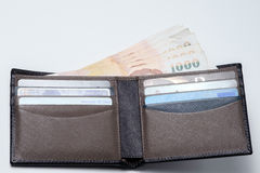 Thai money and credit card in lather wallet . Stock Photography