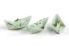 Thai money folded into the shape of a boat. Royalty Free Stock Photo