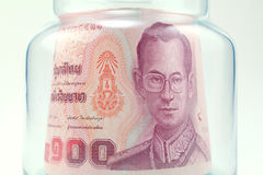 Thai money in the glass bottle Stock Image