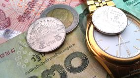 Thai money and gold watch Royalty Free Stock Photography