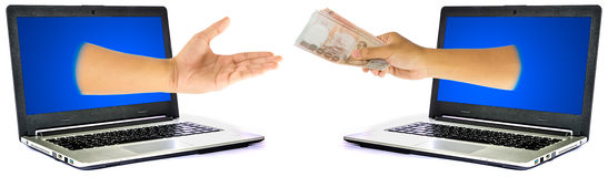 Thai Money in hand from laptop Royalty Free Stock Photo