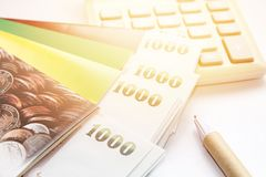 Thai money, pen, calculator and savings account passbook on white background Stock Images