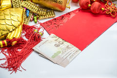 Thai money  red envelope with golden stuff for chinese new yea Royalty Free Stock Photo