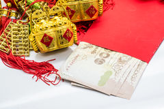 Thai money  red envelope with golden stuff for chinese new yea Stock Photos
